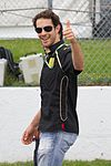 Bruno Senna wearing a black T-shirt with sponsors logos and jeans at the 2011 Canadian Grand Prix