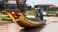 Cambodian man in his boat.jpg