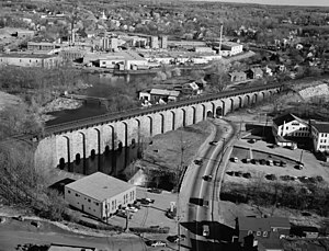 Canton, Massachusetts - A west side view of the Canton Viaduct looking south with the former Revere Copper Mill in the background, April 1977.