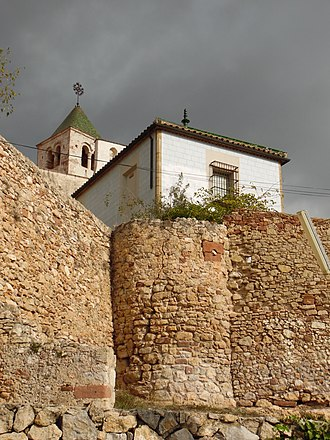 Castelldefels Castle - The church of St. Mary within the curtain wall, with the base of a 14th-century tower in the foreground