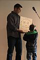 Chaplain builds bridges with smiles by children in need 150206-F-XX999-239.jpg