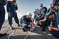 Chief Boatswain's Mate Veng Ngov teaches Sailors how to splice line aboard the guided missile destroyer USS Stockdale (DDG 106), March 12, 2013, in Bahrain 130312-N-HN991-040.jpg