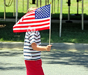 A child holds the American flag during an Inde...