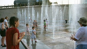 Children play in water fountains, in downtown ...