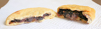 Eccles cake - A Chorley cake (left) and an Eccles cake (right)
