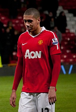 Smalling playing for Manchester United in 2011 Chris Smalling and Wes Brown cropped.jpg