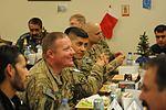 Christmas dinner with the Afghans 131218-A-NS540-086.jpg