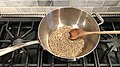 Coffee roasting in a wok on the stove.jpg