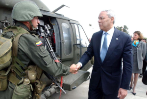 History of the Colombian National Police - Former U.S. Secretary of State Colin Powell during a visit to Colombia greeted by a Colombian National Police patroller.