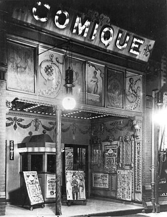 Nickelodeon (movie theater) - A nickelodeon theatre in Toronto, Ontario, Canada, circa 1910. Nickelodeons often used gaudy posters and ornamented facades to attract patrons, but bare walls and hard seats usually awaited within.