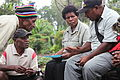 Community discussions about violence against women, White Ribbon Day, PNG, 2011. Photo- AusAID (10687447146).jpg