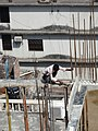 Construction Worker on High-Rise - Dhaka - Bangladesh (12850641585).jpg
