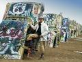 Cowboy at the funky Cadillac Ranch, U.S. Route 66, Amarillo, Texas LCCN2011631210.tif