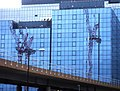 Cranes reflected in a wall of glass - geograph.org.uk - 585989.jpg