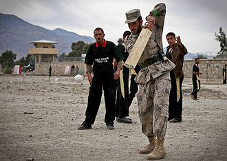 Afghanistan Cricket Board - An Afghan Border Police plays cricket after the ground breaking ceremony for the Ghulam Mohammad Sports Complex in Kunar Province.
