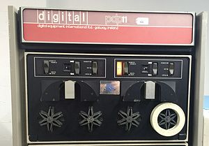 """DECtape - A TU56 dual DECtape unit for a DEC PDP-11.  Note the 6-armed """"starfish"""" hubs holding circular white tape reels in place. The vertical aluminium block above each pair of tape reels holds the read/write heads."""