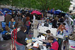 Occupy Wall Street - Encampment at Zuccotti Park and 'People's Library' with over 5,000 books, wi-fi internet, and a reference service, often staffed by professional librarians, procuring material through the interlibrary loan system.