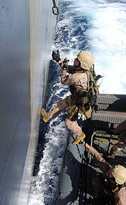 Defense.gov News Photo 110505-N-OS574-627 - Marines prepare for a visit board search and seizure hook and pull exercise with the amphibious transport dock ship USS Mesa Verde LPD 19 in the.jpg