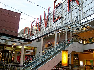 Denver Pavilions is a popular arts, entertainment, and shopping center on the 16th Street Mall in downtown Denver. Denver Pavilions sign and escalators.jpg