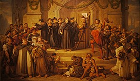 Painting of Martin Luther in monk's garb preaching and gesturing while a boy nails the Ninety-Five Theses to the door before a crowd
