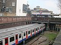 District Line Trains arriving and departing at West Kensington Underground Station - geograph.org.uk - 1229531.jpg