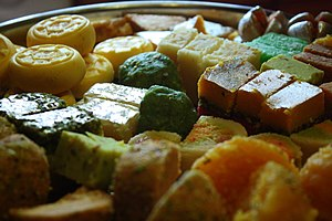 Vark - A tray of South Asian sweets, with some pieces covered with shiny vark.
