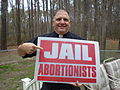 Donald Spitz holds anti-abortion sign.jpg