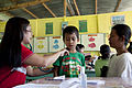 Dr. Mary Ann Navarro, a provincial health officer with Palawan Provence, check a young boy's lungs at Quinlogan Elementary School, Palawan, Philippines, Oct. 22, 2011 111022-M-VG363-124.jpg
