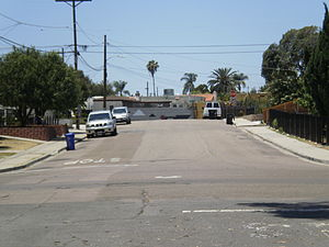 PSA Flight 182 - PSA 182 crash site as it appeared in 2010: Looking west down Dwight St., Nile Street intersection is in foreground; Boundary St. intersection in background. The initial impact was about 30 feet to the right of the photographer, on Nile St.
