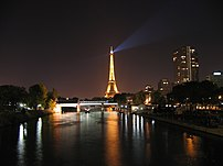 The Eiffel tower and the Seine at night