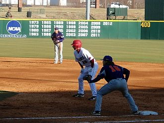 Evansville Purple Aces - Evansville first baseman John Day holds an Arkansas runner on first base in Baum Stadium
