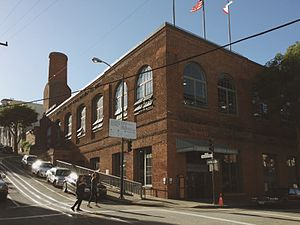 San Francisco Cable Car Museum - Exterior of the Ferries and Cliff House Railway Co. Building Constructed in 1887. Houses both the cable car winding station, engines, and museum. The smoke stack in the rear was damaged in the 1906 San Francisco earthquake, restored then soon decommissioned when steam power was replaced with electrical power at the winding station.