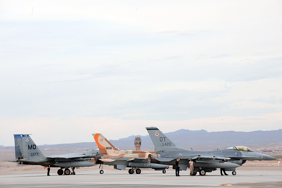 F-15C Eagle, Israeli F-16I and F-16 Fighting Falcon wait at the end of the runway at Nellis AFB during Red Flag 09-4
