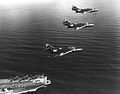 F9F-6 Cougars of VF-103 over USS Coral Sea (CVA-43) 1954.jpg