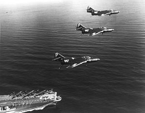 VFA-103 - Image: F9F 6 Cougars of VF 103 over USS Coral Sea (CVA 43) 1954