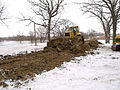 FEMA - 40328 - A worker increases the height of a dike with construction equipment in Fargo.jpg