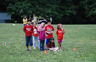 Fairfax County, Virginia - Children play frisbee baseball at one of Fairfax County's elementary schools.
