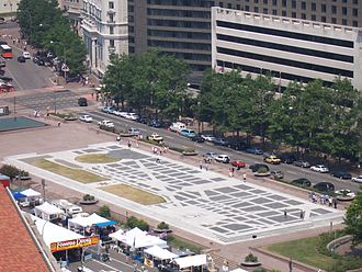 Freedom Plaza - The plaza's inlaid stone depicts parts of Pierre (Peter) Charles L'Enfant's plan for the City of Washington, showing Federal Triangle, the United States Capitol, the White House and part of the National Mall, as well as the plan's legends. View from the 12th floor of the Clock Tower on the Old Post Office Building, looking northwest along Pennsylvania Avenue. (2005)