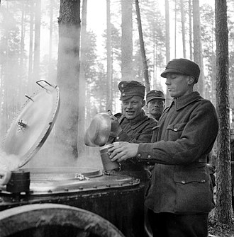 "Winter War - Finnish soldiers gathering breakfast from a field kitchen during ""additional refresher training"" at the Karelian Isthmus on 10 October 1939"
