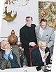 Fr. Michael Pfleger, Rev. Joseph Lowery, Min. Louis Farrakhan and C.T. Vivian conversing in the Rectory dining room (14752023375).jpg
