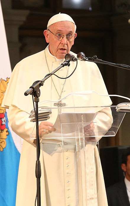 Pope Francis making a speech in the Pontifical Catholic University of Chile (2018). The Catholic Church in Chile in 2018 suffered one of the worst of the worldwide Catholic sexual abuse cases, including the Fernando Karadima case, resulting in several convictions and resignations. Francisco en la PUC (25879476708) - cropped.jpg