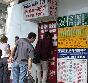 Chinatown bus lines - Passengers waiting at the Fung Wah Lines ticket window on Canal Street and the Bowery in Manhattan's Chinatown.