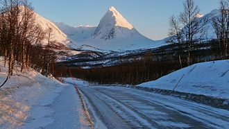 Troms - The 1505 m / 5000 ft Piggtind in the Lyngen Alps, at the intersection of Tromsø, Balsfjord and Storfjord municipalities. February 2009.