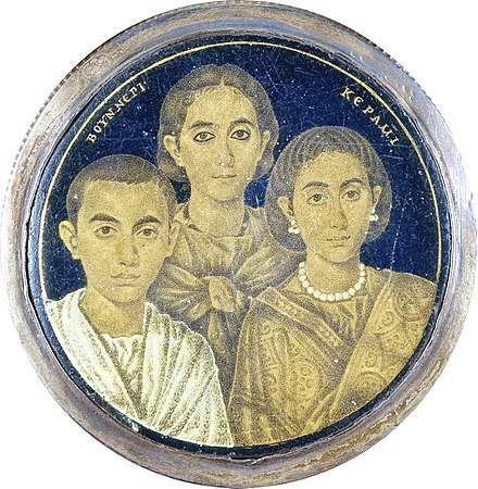 A gold glass portrait of a family from Roman Egypt. The Greek inscription on the medallion may indicate either the name of the artist or the pater familias who is absent in the portrait. Galla Placidia (rechts) und ihre Kinder.jpg