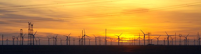 The Gansu Wind Farm in China is the largest wind farm in the world, with a target capacity of 20,000 MW by 2020. Gansu.Guazhou.windturbine farm.sunset.jpg