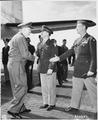 Gen. George C. Marshall shakes hands with Maj. Gen. John R. Deane, center, as Brig. Gen. Ben Stewart Cutler extends... - NARA - 198864.tif