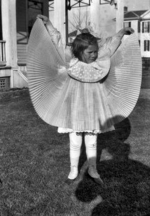 Pleat - Girl holding up pleated skirt