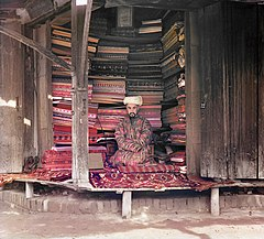 A fabric merchant in Samarkand, ca. 1910