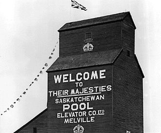 Melville, Saskatchewan - Grain elevator in Melville decorated for the visit of King George VI and Queen Elizabeth in May, 1939.