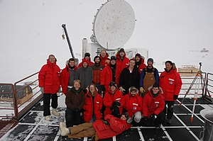 South Pole Telescope - The South Pole Telescope. A picture of the South Pole Telescope collaboration in front of the telescope
